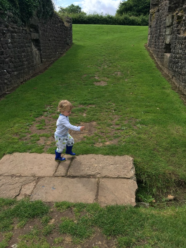 Caerleon-the-roman-fortress-of-isca-a-toddler-marching-with-ruins