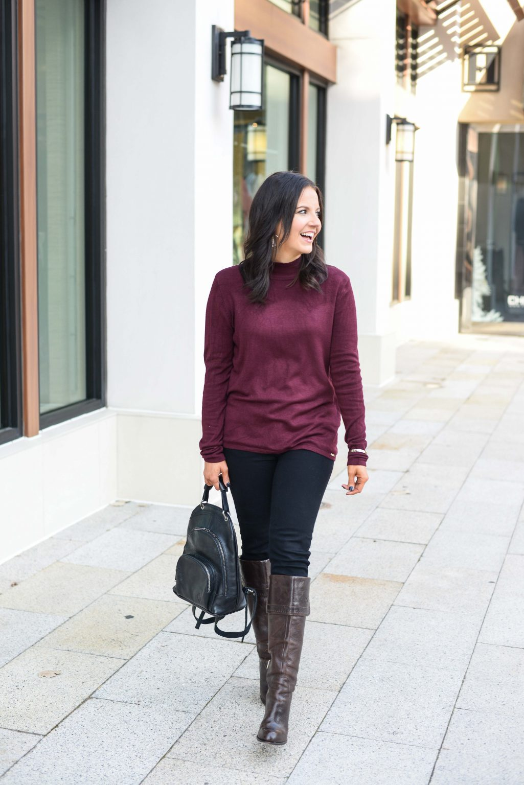 Fashion blogger Karen in maroon sweater and jeans