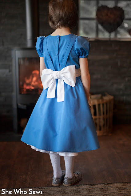 White bow over blue dress with petticoat