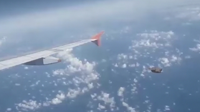 UFO Filmed over Poland by shocked eye witness filming it all from a plane window.