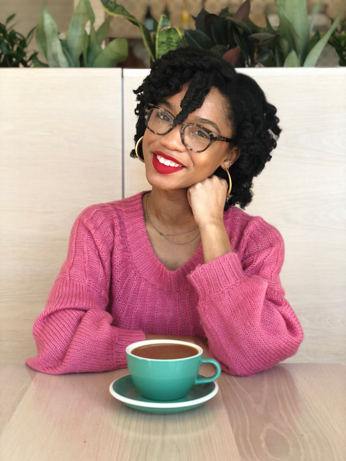 NC blogger wearing red lipstick and smiling wearing a pink sweater and perm rod set