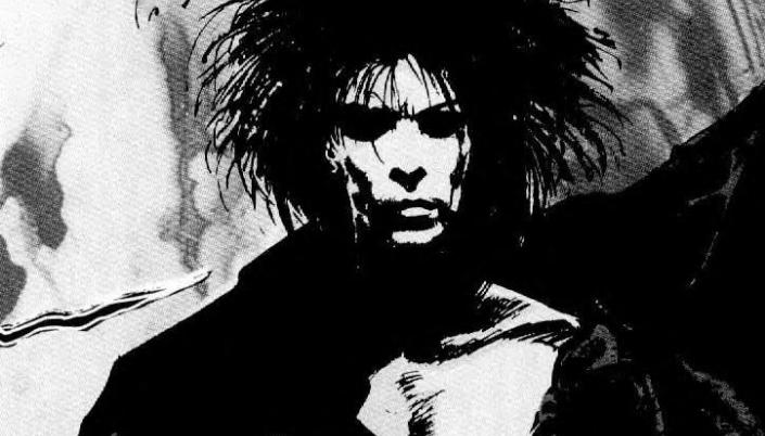 Imagem: uma ilustração dos quadrinhos do personagem Morfeus, um homem muito pálido com um rosto branco coberto por sombras, os cabelos enormes e pretos e desordenados, os olhos completamente pretos, vestido numa roupa preta.
