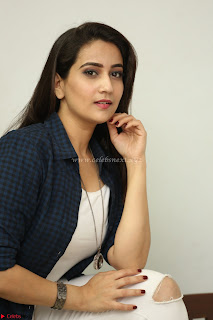 Manjusha in White Tight T Shirt and Black Jacket ~  Exclusive Celebrities Galleries 003