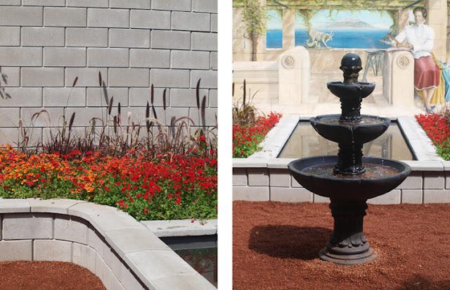 Haverum med vandkundt og bede i glødende farver