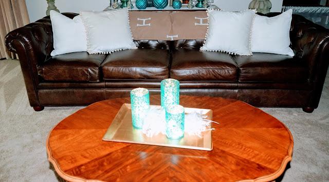 Chesterfield sofa, pom pom pillows, velvet pillows, french provincial coffee table, gold tray