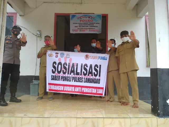 Sosialisasikan Saber Pungli Polsek Delang Kunjungi Kantor Desa Penyombaan