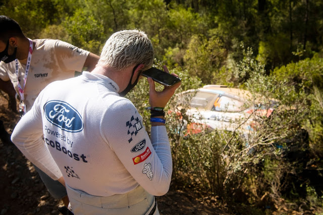Gus Greensmith inspects the damage to his Ford Fiesta World Rally Car during Rally Turkey