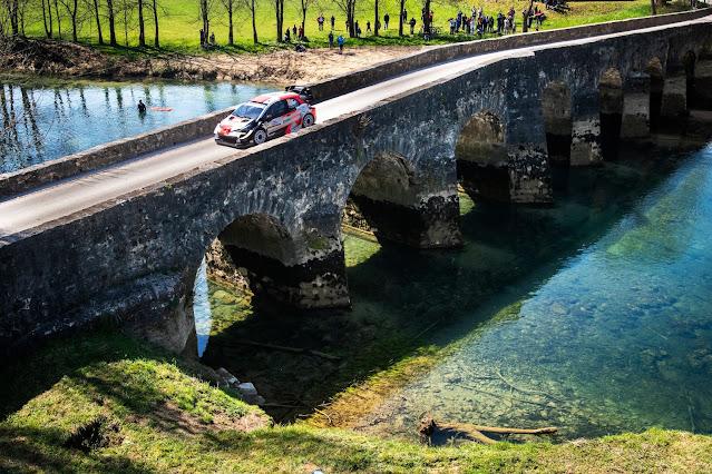 Rally car over a bridge