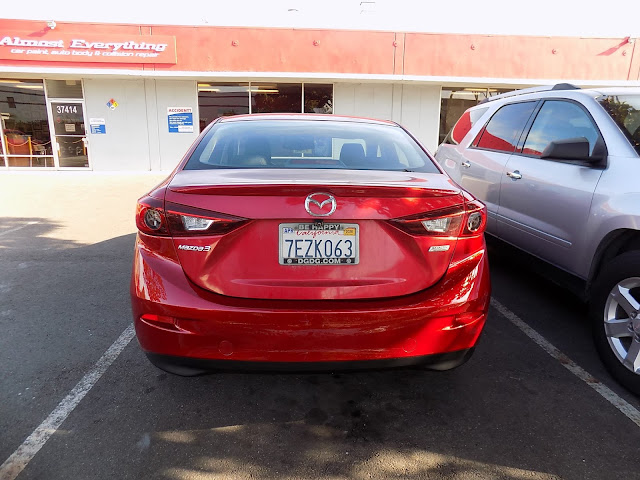 "Mazda 3 after repairs & tri-stage ""Soul Red"" paint at Almost Everything Auto Body."