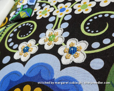 Three bead embroidered flowers. (Wild Child Japanese Bead Embroidery by Mary Alice Sinton)