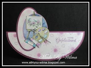 Een wiebel- of schommelkaart met een plaatje van een schilderspalet. A wobble- or swingcard with a picture of a painter's palette.