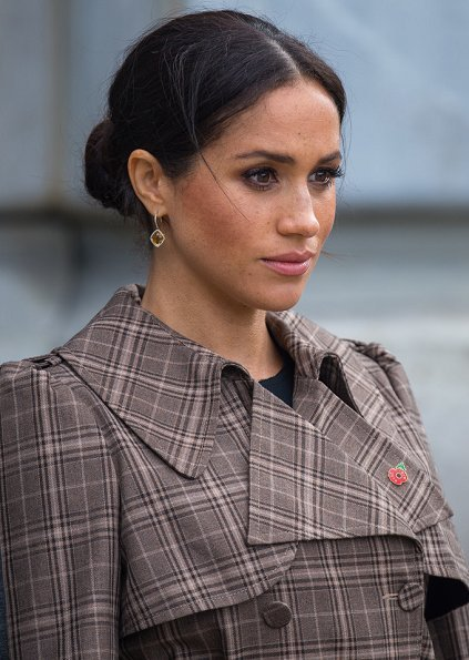 Meghan Markle wore Karen Walker Banks coat, Asos Design Maternity dress, Sarah Flint pumps and Birks Musecitrine and diamond drop earrings