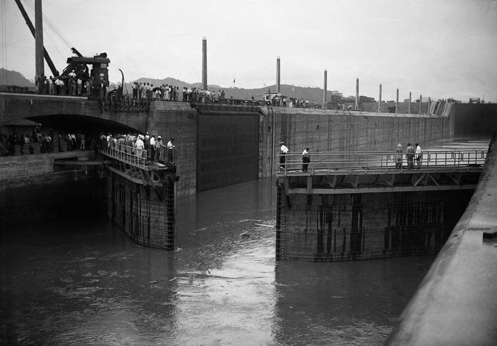 The gates of the Miraflores Locks open for testing. 1913.
