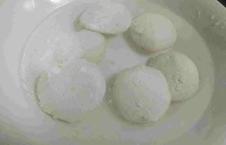 Rasmalai dipped in sugar syrup to set