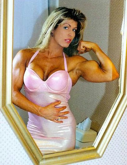 Marianna Komlos was a Canadian bodybuilder, fitness model, wrestling valet