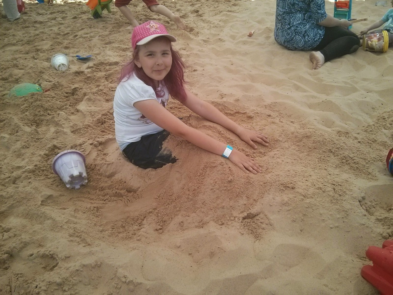 Top Ender burying her legs in the sand