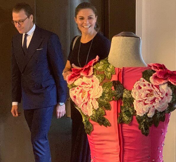 Crown Princess Victoria wore new pleated skirt from HM, navy duchess earrings from Ebba Brahe, and Rakel navy blue boots from af Klingberg