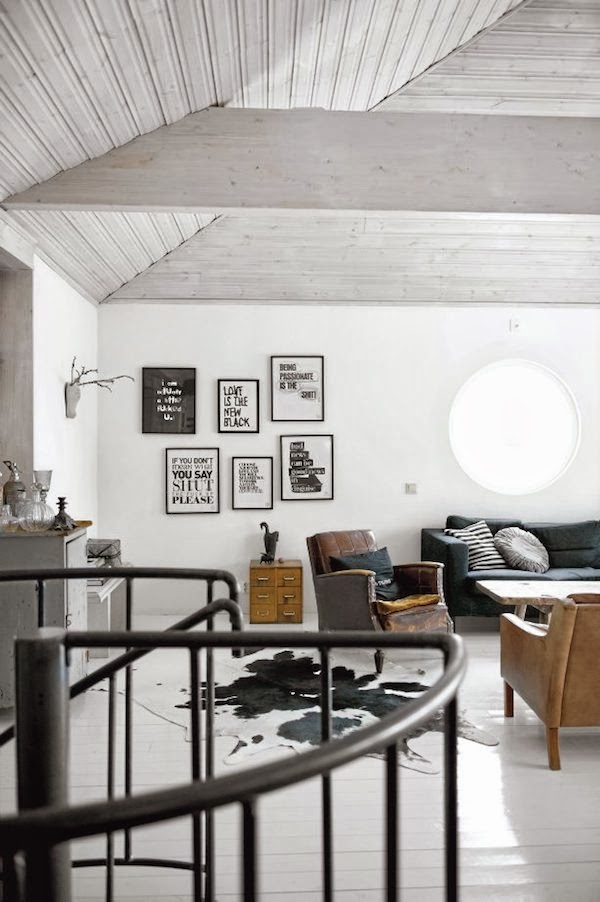 Industrial pieces and black white prints in a swedish white home