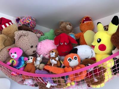 Teddies in a pink teddy hammock