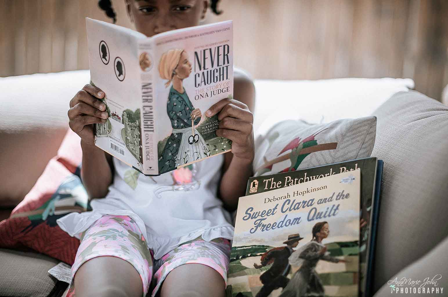 Child Reading Book for Juneteenth