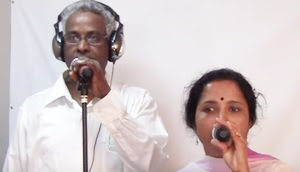 Maniyosai Kettu Ezhunthu Song by Victor and Usha