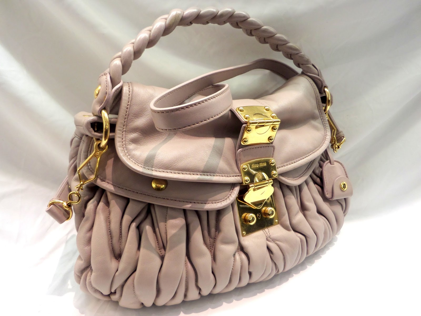 fe9875e047fe ... Miu Matelasse Lux Leather Coffer Bag on consignment at  OnceAgainOnline.com. Free shipping within Canada and USA. 100% authenticity  guarantee!!