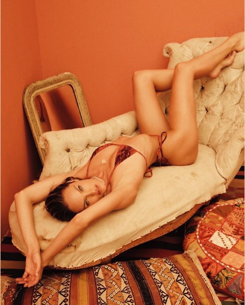 Candice Swanepoel flaunts her figure in Tropic of C resort 2021 swim campaign.