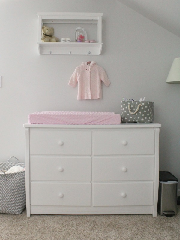 Pink and gray nursery for a baby girl: Use a dresser instead of a changing table. I love the cute star canvas and rope basket as a diaper caddy!