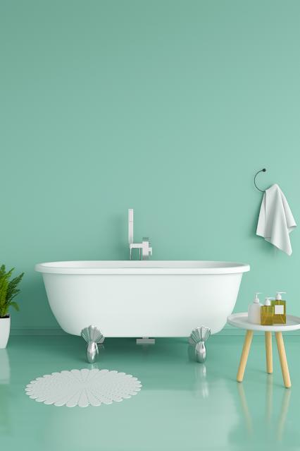 Pretty bathroom with aqua walls, white tub.
