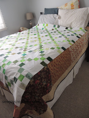 side view irish chain quilt top on queen size bed