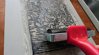 Rolling the ink onto the Sammael lino block