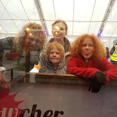 My family staring at me through glass at Manchester Ice Rink at Media City