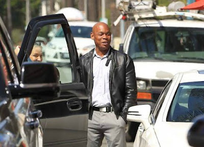 Mahiely Woodbine's husband Bokeem surrounded by cars