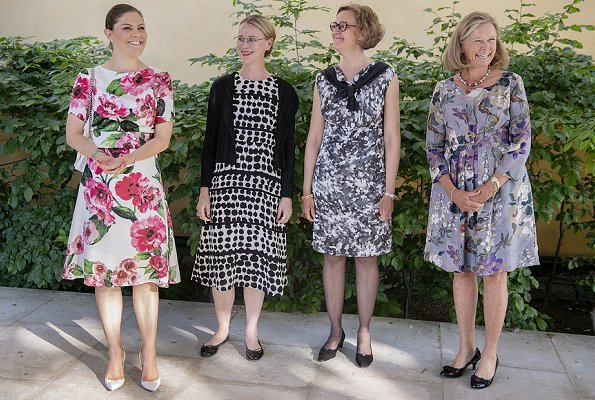 Crown Princess Victoria wore a floral dress from the Swedish Brand Dughult of Sweden and paired it with her white Gianvito Rossi Pumps