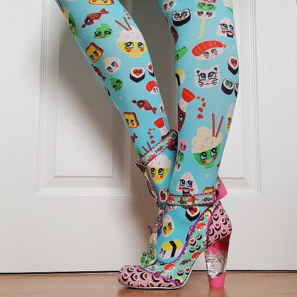 legs wearing colourful sushi theme tights and printed shoe with lucite heel