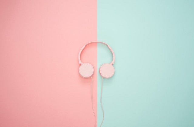 pink headphones on pastel pink and green background