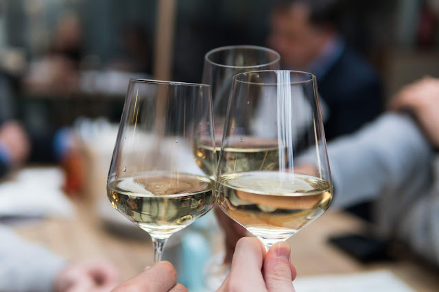 toasting with three glasses of wine Photo by Matthieu Joannon on Unsplash