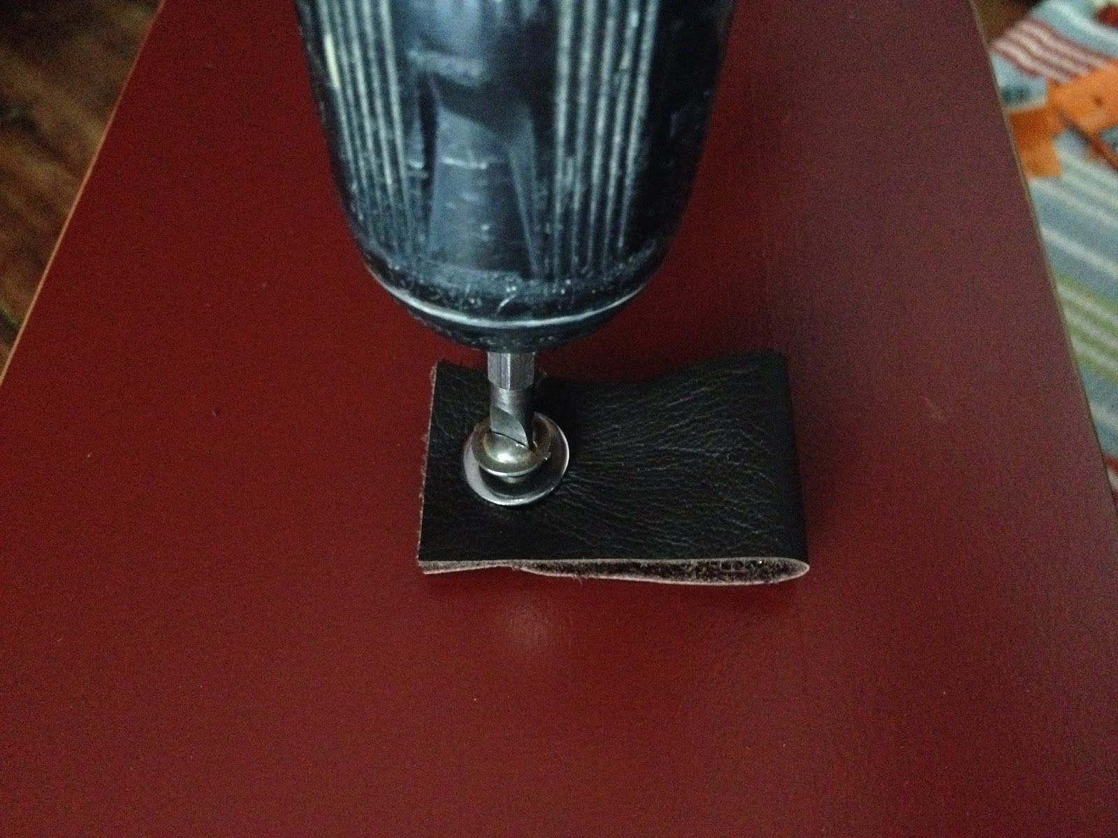 attaching leather pull to drawer