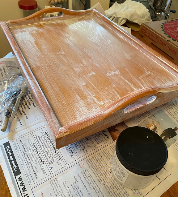 Photo of a stain & odor blocker being brushed on a tray