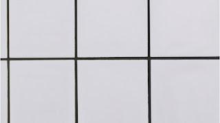 Azulejos blancos con lechada negra