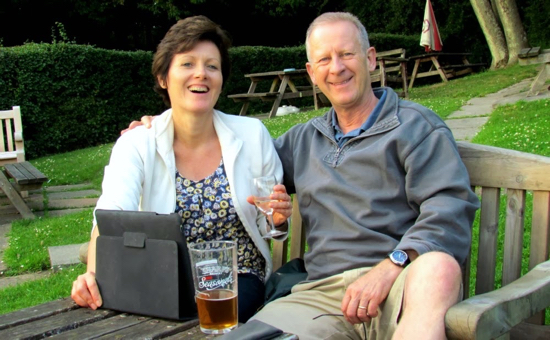 Picture of Ellie and Dave Brewer in the Woodman, Wildhill, beer garden recovering from one of the walks - July 2011