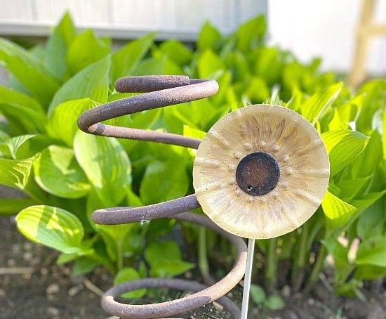 Metal DIY sunflowers for a junk garden
