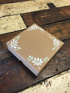 Add daisies to gift boxes