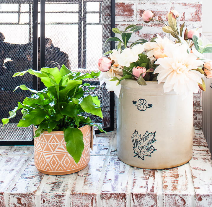 birds nest fern and antique crock filled with Spring florals