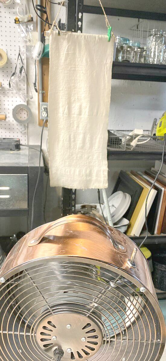 Hanging drop cloth to dry in front of a fan