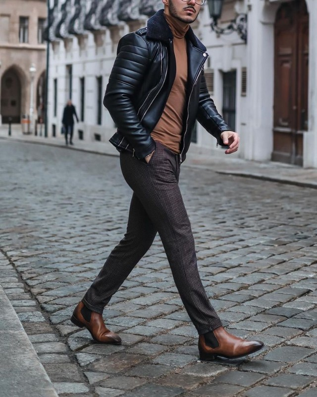 Leather jacket + high neck sweatshirt + Chelsea boots + trousers.