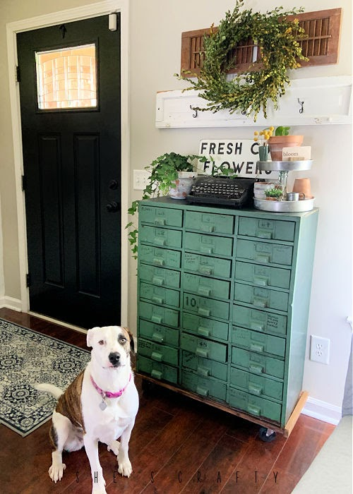 Spring Home Tour - living room shop cabinet decor with plants and typewriter.