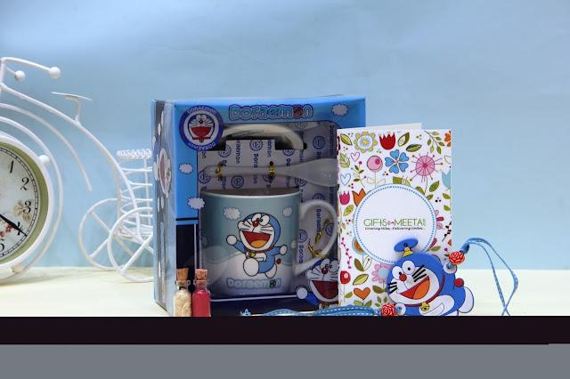 Doraemon with Mug Kids Rakhi Combo