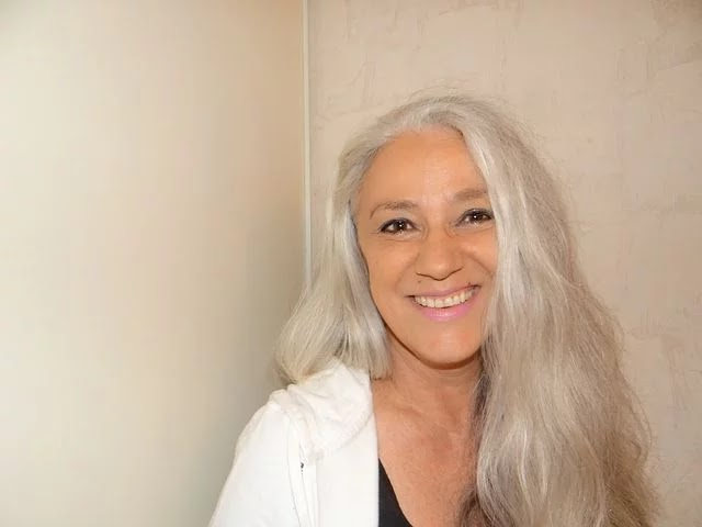 Grey haired women in her 50s. Image courtesy of Pixabay