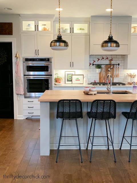 white kitchen gray island black hardware